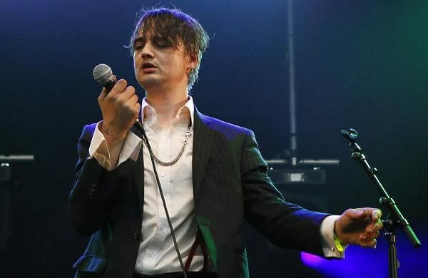 British musician Pete Doherty performs on stage during a concert in Paris (AP Photo/Francois Mori, File)