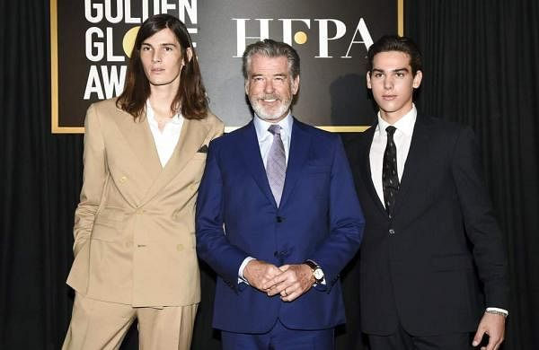 Dylan Brosnan, from left, Pierce Brosnan, and Paris Brosnan attend the Golden Globe Ambassador reveal (Photo by Dan Steinberg/Invision/AP)
