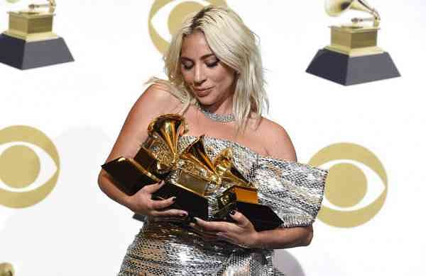 Lady Gaga in the press room with her awards at the 61st annual Grammy Awards (Photo by Chris Pizzello/Invision/AP, File)