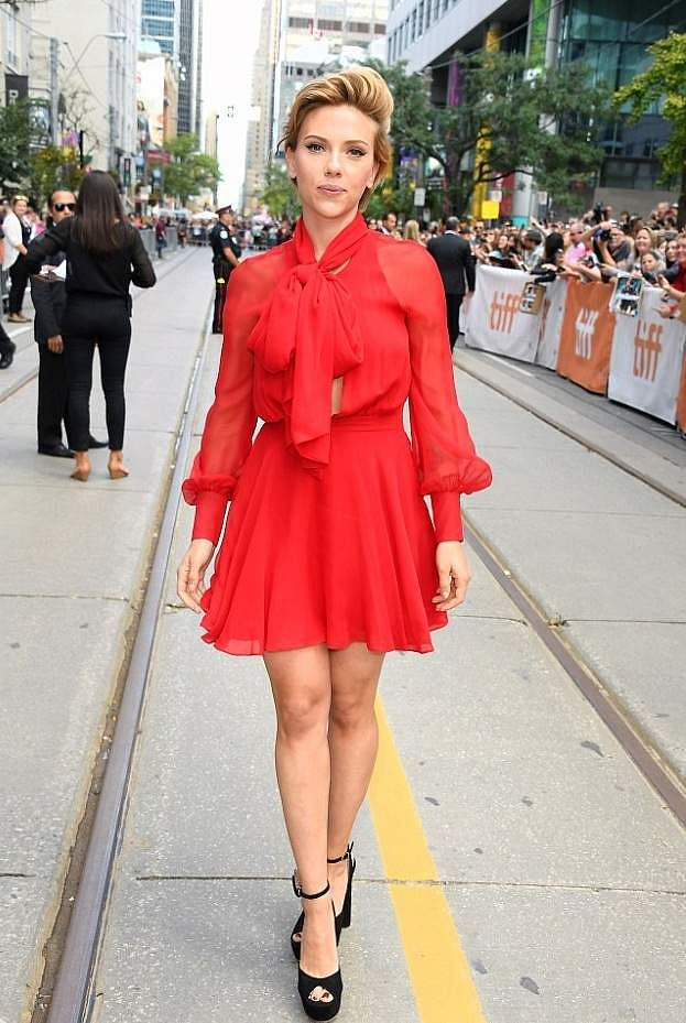 At the 2016 Sing premiere, ScarJo wore a red Haney mini dress featuring a bow and long sheer sleeves