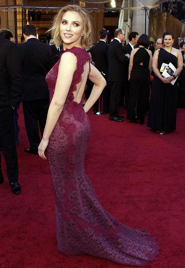 Johansson attends the 83rd Annual Academy Awards in a wine Dolce & Gabbana gown with an open back