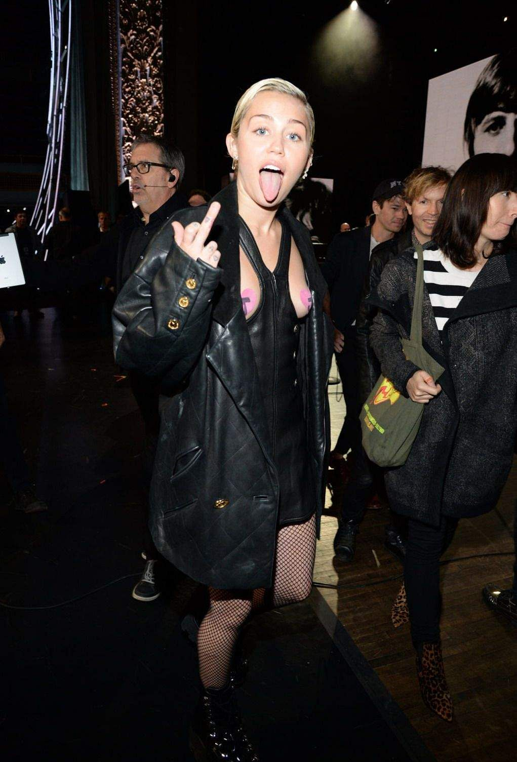 Miley Cyrus attends the 30th annual rock and roll hall of fame induction ceremony with pink pasties