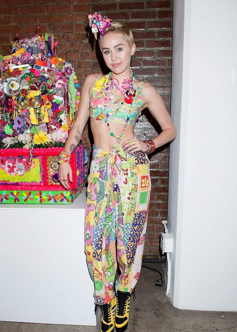 Miley attends the Jeremy Scott fashion show held during the MADE Fashion Week Spring 2016