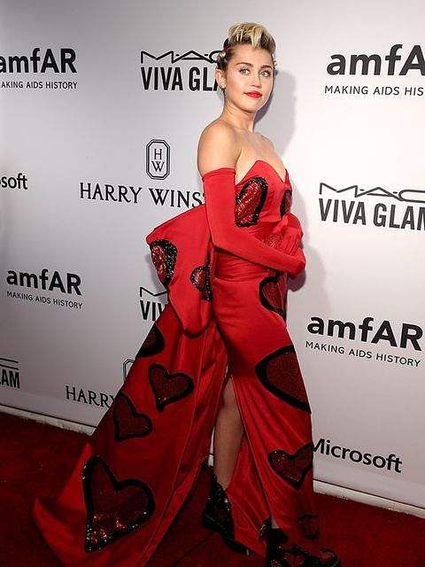 Only Miley can get away with a Jeremy Scott gown and Doc Marten boots at the 2015 AMFAR Awards