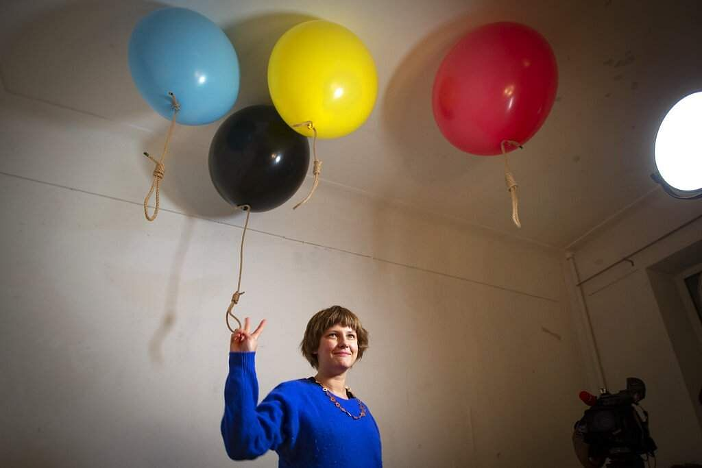 Artist Michele Pagel at her show, Polly wants a Cracker, which focuses on domestic abuse. Moscow's suburbs are the focus of an exhibition in the Russian capital. (AP Photo/Alexander Zemlianichenko)