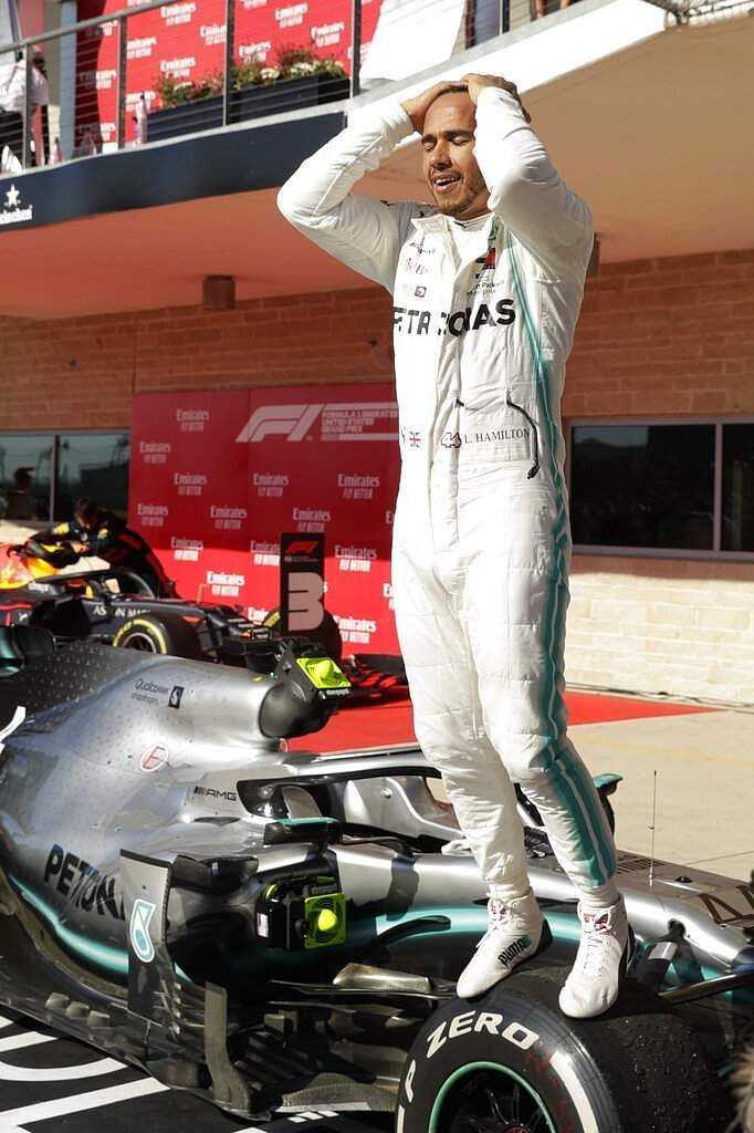 Mercedes driver Lewis Hamilton, of Britain, reacts following the Formula One U.S. Grand Prix auto race at the Circuit of the Americas, in Austin, Texas. (AP Photo/Eric Gay)