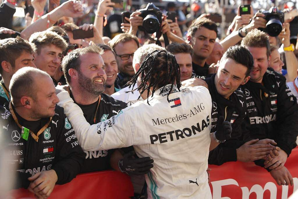Mercedes driver Lewis Hamilton celebrates with his crew following the Formula One U.S. Grand Prix auto race at the Circuit of the Americas, in Austin, Texas. (AP Photo/Eric Gay)