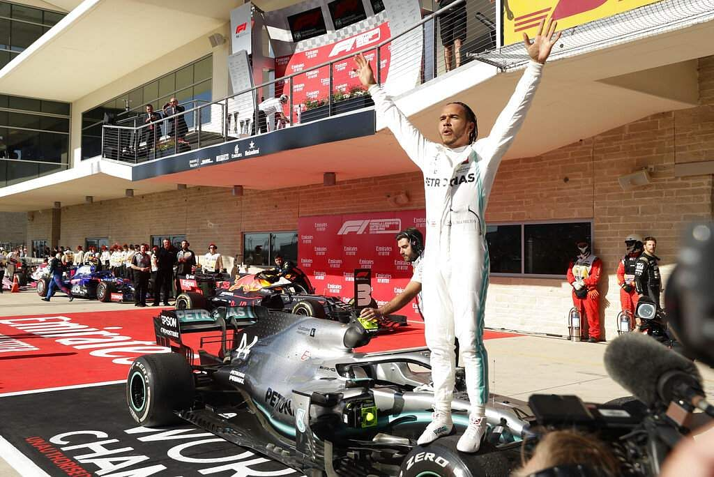 Mercedes driver Lewis Hamilton, of Britain, celebrates following the Formula One U.S. Grand Prix auto race at the Circuit of the Americas, in Austin, Texas. (AP Photo/Eric Gay)