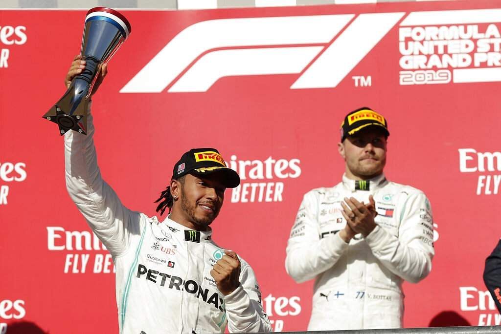 Mercedes driver Lewis Hamilton, of Britain, celebrates following the Formula One U.S. Grand Prix auto race at the Circuit of the Americas, Sunday, Nov. 3, 2019, in Austin, Texas. (AP Photo/Eric Gay)