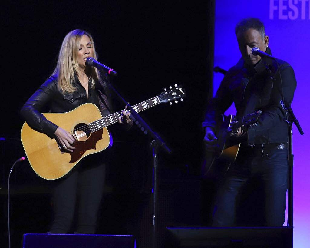 Sheryl Crow, left, and Bruce Springsteen (Photo by Greg AllenInvisionAP)