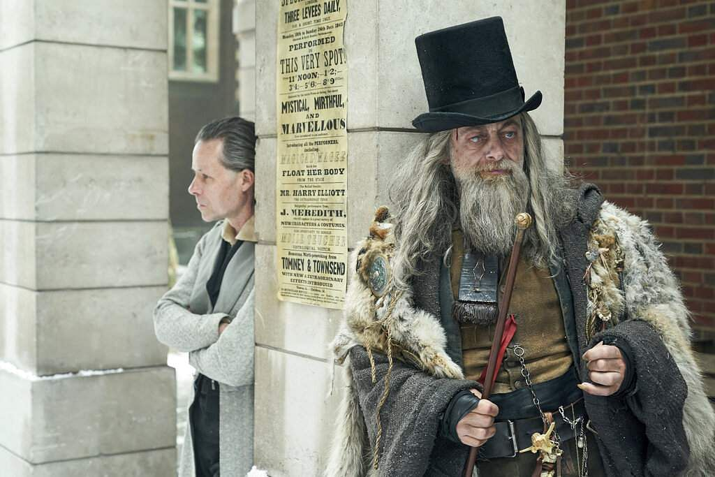 Guy Pearce as Ebenezer Scrooge and Andy Serkis as the Spirit of Christmas Past in A Christmas Carol (Robert Viglasky/FX Networks via AP)