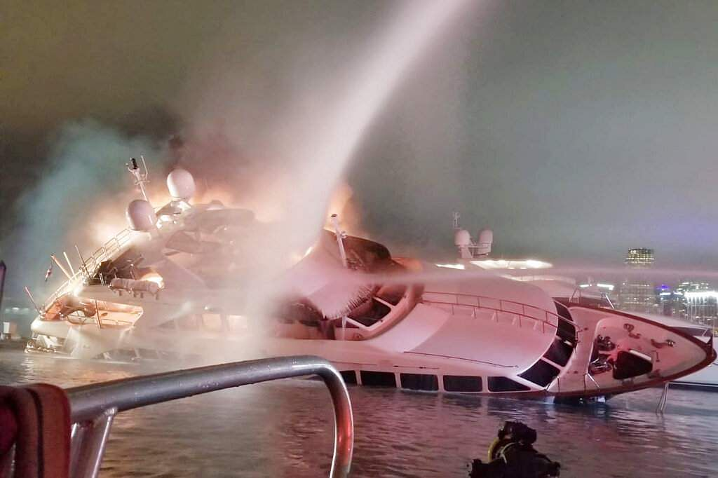 Marc Anthony's yacht at a dock in Miami (Miami-Dade Fire Rescue via AP)