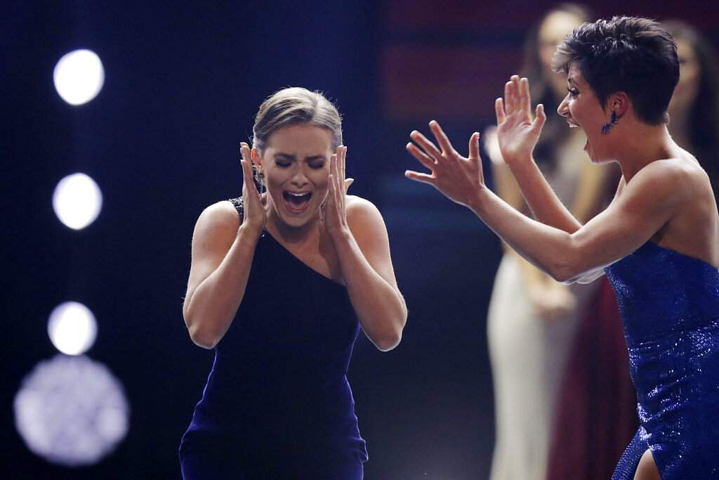 Camille Schrier, of Virginia, reacts after winning the Miss America competition at the Mohegan Sun casino. At right is runner-up Miss Georgia Victoria Hill. (AP Photo/Charles Krupa)