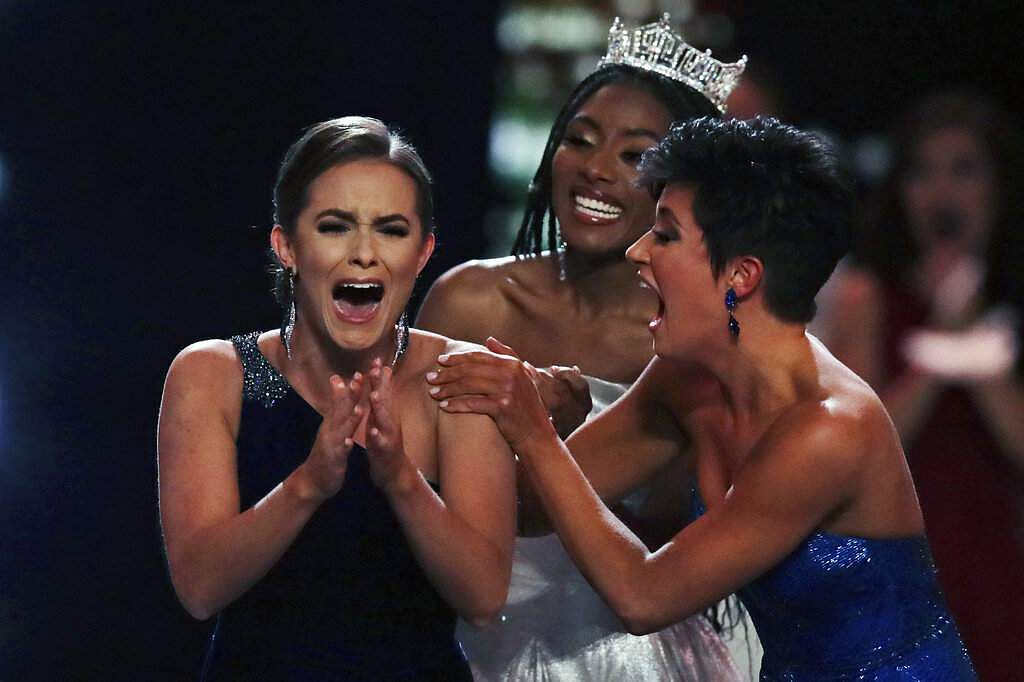 Camille Schrier reacts after winning the Miss America competition at the Mohegan Sun casino. At right is runner-up Georgia Victoria Hill and and at rear is Nia Franklin. (AP Photo/Charles Krupa)
