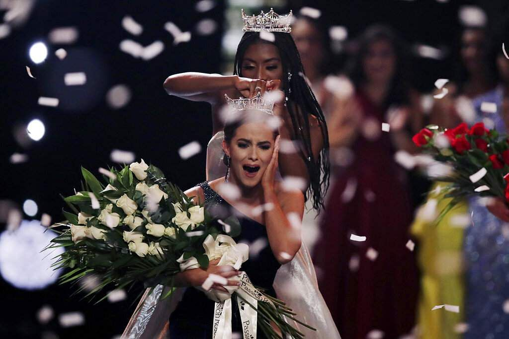 Camille Schrier, of Virginia, reacts reacts as she is crowned after winning the Miss America competition at the Mohegan Sun casino. At rear is 2019 Miss America Nia Franklin. (AP Photo/Charles Krupa)