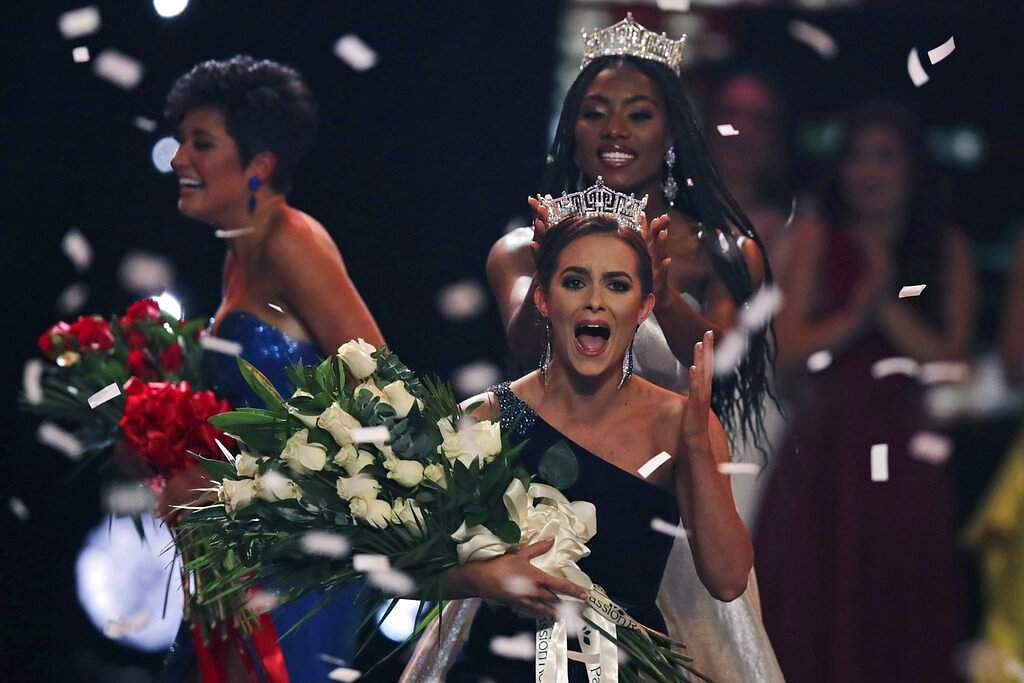 Camille Schrier reacts as she is crowned after winning the Miss America competition at the Mohegan Sun casino in Uncasville, Conn. At rear is 2019 Miss America Nia Franklin. (AP Photo/Charles Krupa)