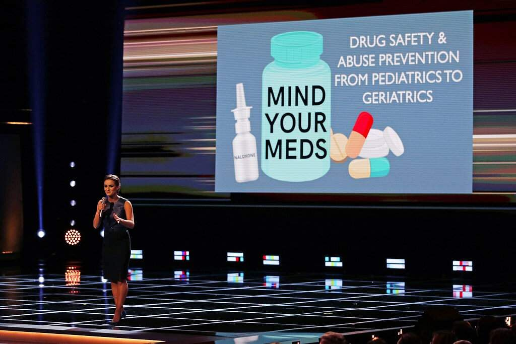 Camille Schrier, of Virginia, addresses her concern about drug safety to the audience prior to winning the Miss America competition at Mohegan Sun casino in Uncasville, Conn. (AP Photo/Charles Krupa)