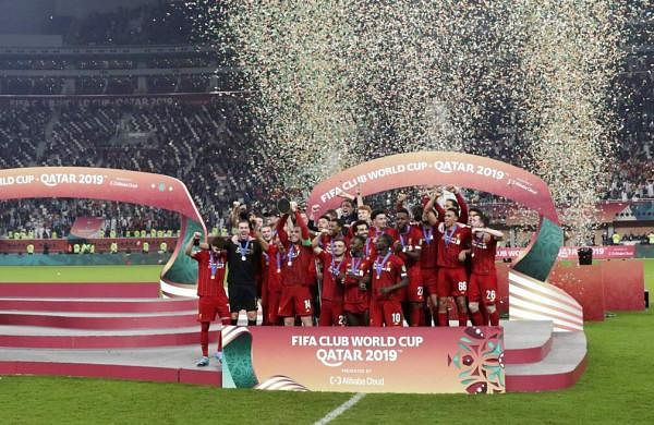 Players of Liverpool celebrate after winning the Club World Cup final soccer match between Liverpool and Flamengo at Khalifa International Stadium in Doha, Qatar. (AP Photo/Hassan Ammar)