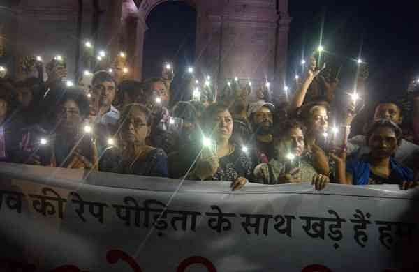 A candle light protest in New Delhi (Photo: IANS)