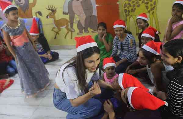 Mouni Roy plays Santa Claus (Photo: IANS)