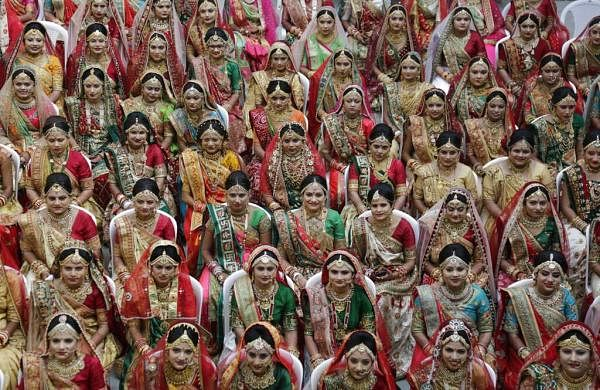 Brides sit for a mass wedding in Surat, India. More than a hundred couples tied the knot at the gathering. (AP Photo/Ajit Solanki)