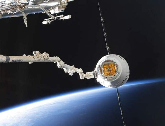 SpaceX Dragon capsule at the ISS (NASA via AP)