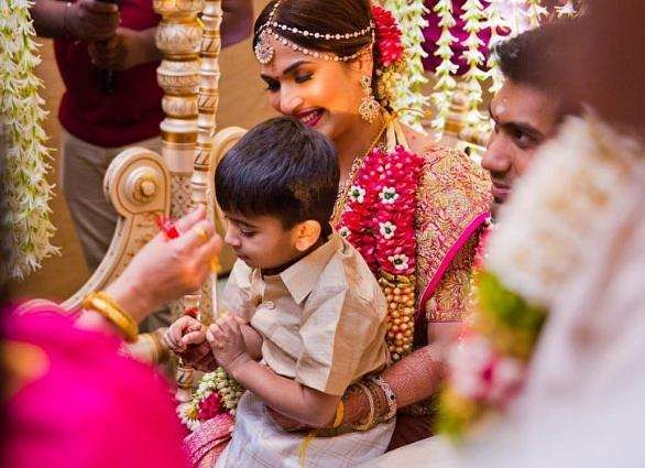 Soundarya Rajinikanth and her son Ved Kumar at the marriage ceremony in Chennai on Monday.