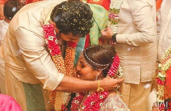 Vishagan and Soundarya share an intimate moment at their wedding ceremony in Chennai on Monday