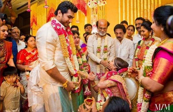 Vishagan puts the garland around Soundarya's neck at their ceremony in Chennai on Monday.