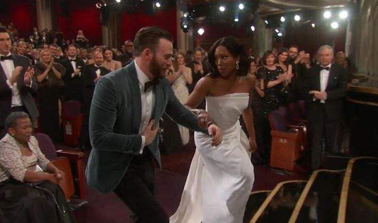 Chris Evans helps Regina King