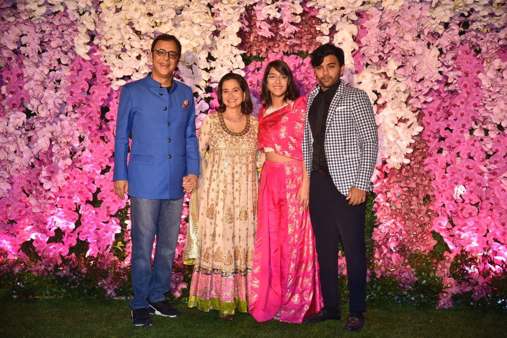 Director Vidhu Vinod Chopra along with his wife Anupama Chopra and children at the wedding reception of Akash Ambani and Shloka Mehta in Mumbai on March 10, 2019. (Photo: IANS)