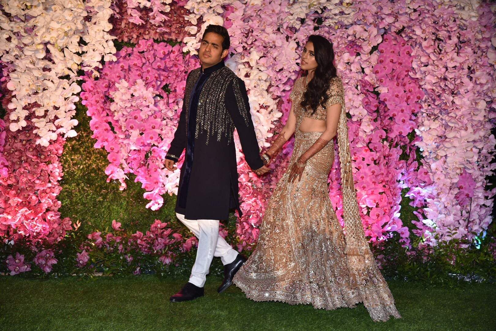 Akash Ambani and Shloka Mehta Ambani during their wedding reception at Jio World Garden in Mumbai on March 10, 2019. (Photo: IANS)