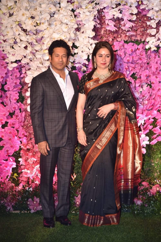 Cricket legend Sachin Tendulkar along with his wife Anjali Tendulkar at the wedding reception of Akash Ambani and Shloka Mehta in Mumbai on March 10, 2019. (Photo: IANS)