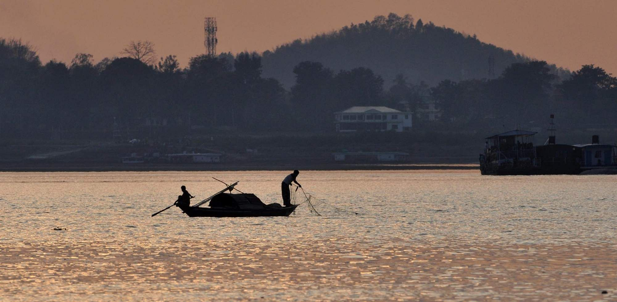 Guwahati: Fishermen busy fishing in Brahmaputra river in Guwahati on March 2, 2019. (Photo: IANS)