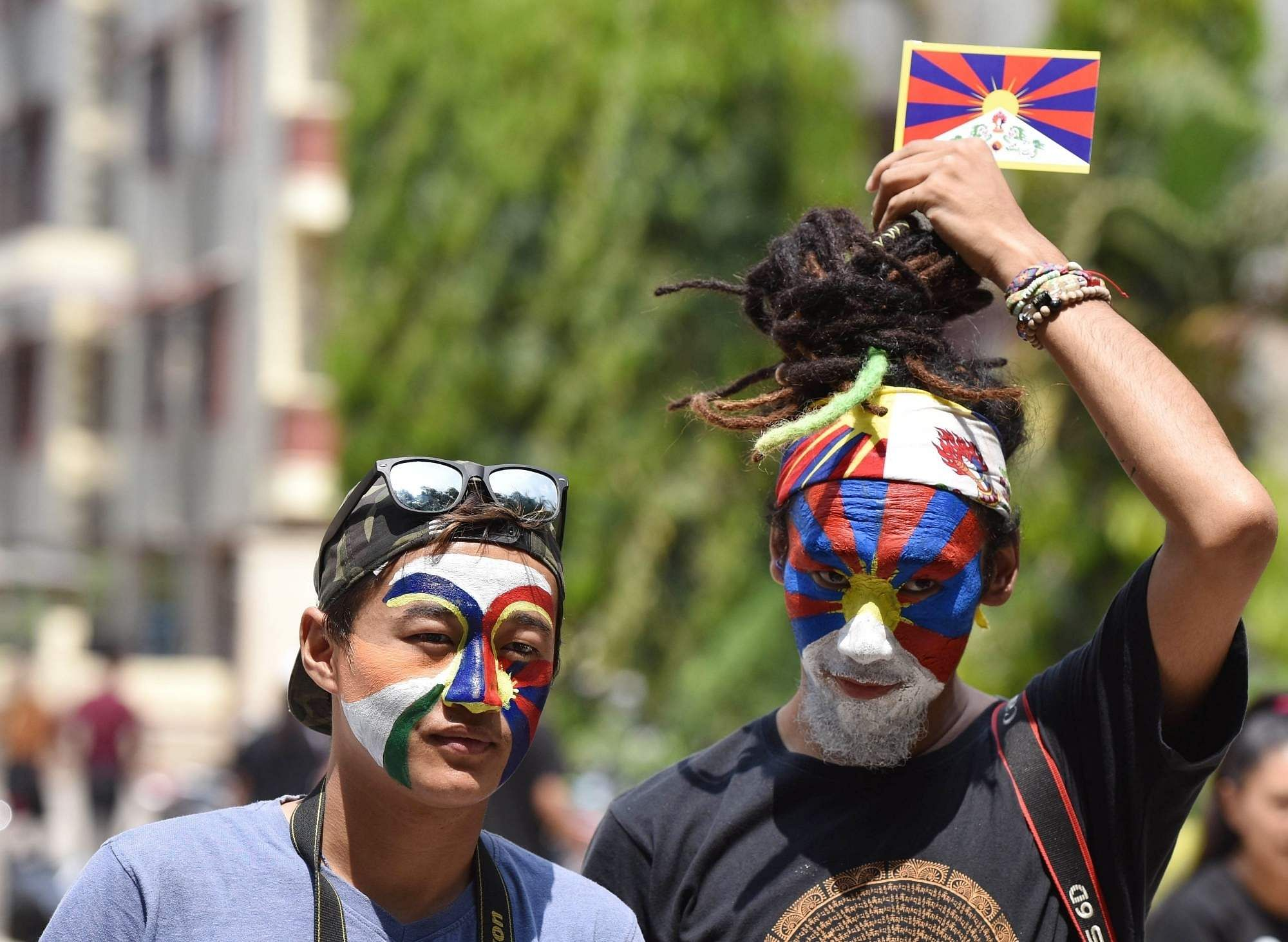 Bengaluru: Tibetans in exile participate in a rally organised to mark the 60th anniversary of the Tibetan National Uprising Day, in Bengaluru on March 10, 2019. (Photo: IANS)
