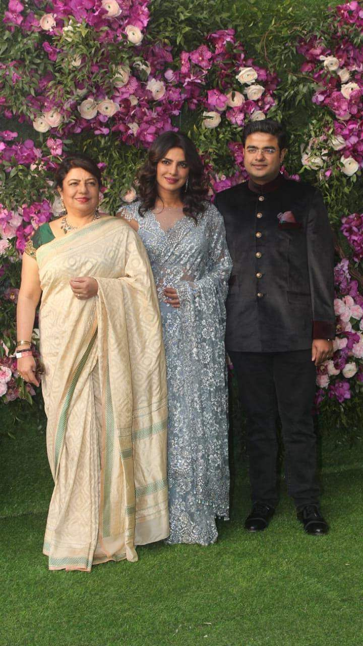 Priyanka Chopra with her mother and brother