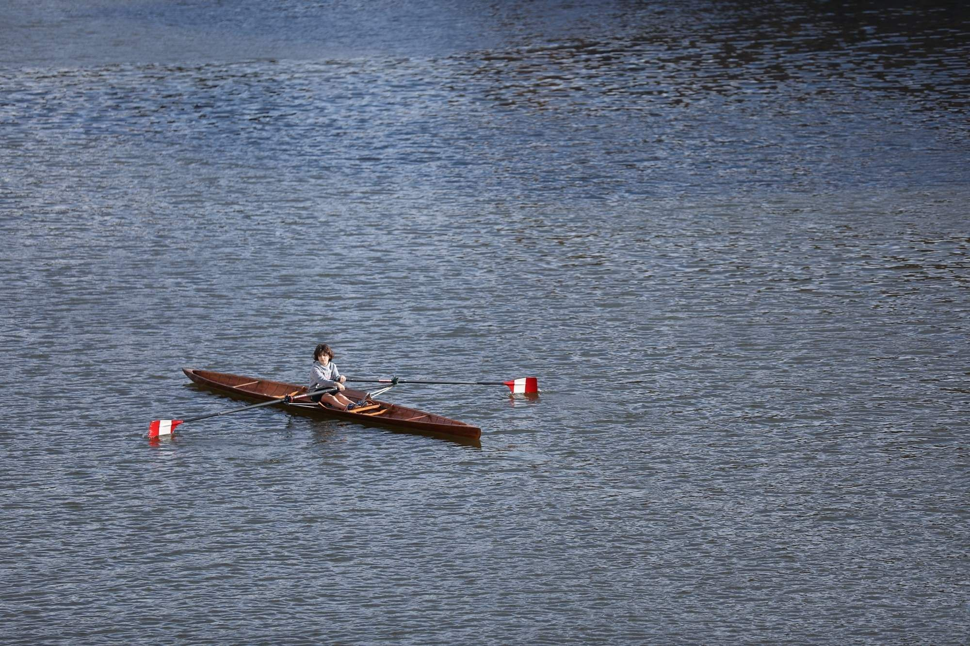 ROME, March 11, 2019 (Xinhua) -- A boy canoes on Arno River in Florence, Italy, March 8, 2019. (Xinhua/Cheng Tingting/IANS)