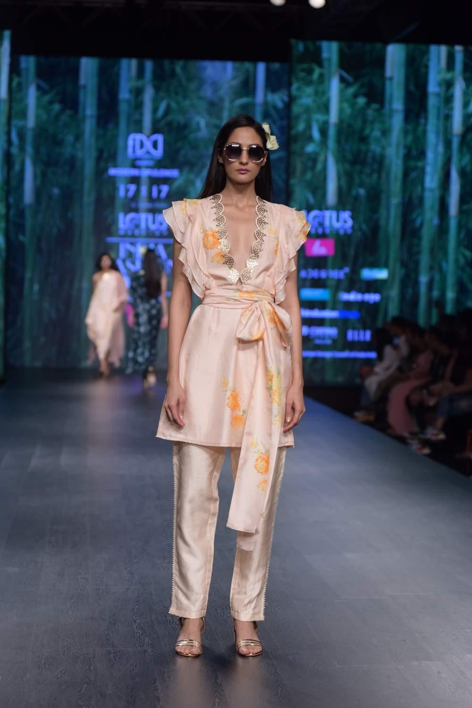 A model showcases a creation of fashion designer Simmi Saboo on the third day of Lotus India Fashion Week in New Delhi, on March 15, 2019. (Photo: Amlan Paliwal/ IANS)