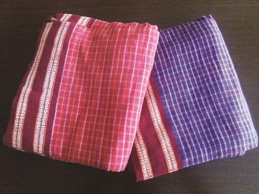 Kunbi saris from Goa. The violet blue was worn by widows, 20th century. (Courtesy: John Fernandes, Quepe/Photo: Mahesh Tuenker/Moda Goa Museum)