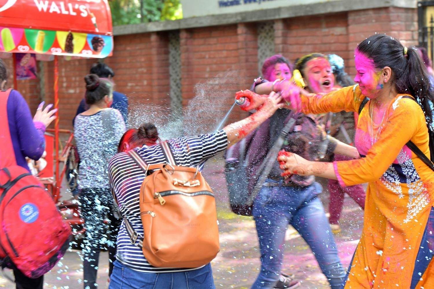 New Delhi: College students celebrate Holi on the eve of the festival in New Delhi, on March 20, 2019. (Photo: IANS)