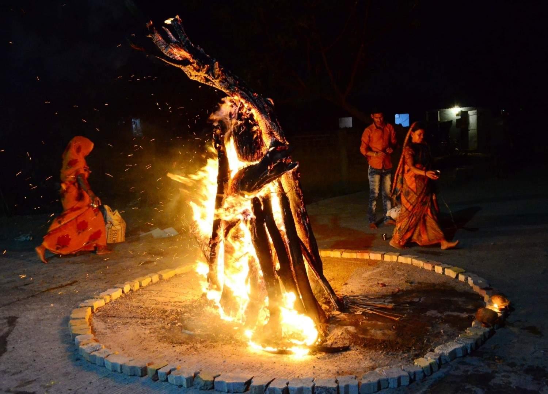 Nagpur: Holika Dahan, burning of holy pyres, underway on the eve of Holi in Nagpur on March 20, 2019. (Photo: IANS)