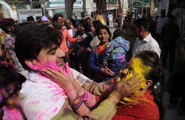 Amritsar: Devotees celebrate Holi at Durgiana Temple, in Amritsar, on March 20, 2019. (Photo: IANS)