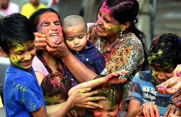 Bengaluru: People play with colours on the eve of 'Holi' in Bengaluru on March 20, 2019. (Photo: IANS)