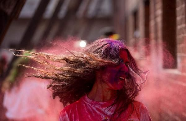 Kathmandu, March 20, 2019 (Xinhua) - A girl plays with coloured powder during Holi at the premises of Basantapur Durbar Square in Kathmandu, Nepal. (Xinhua/Sulav Shrestha/IANS)