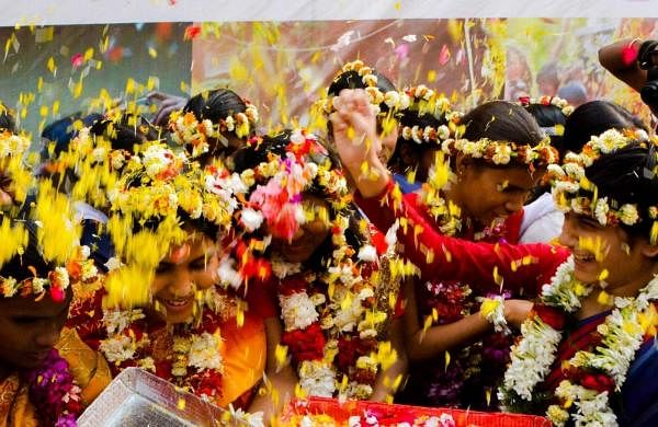 Kolkata: Visually impaired children play with flower petals during 'Phool Dol' Holi celebrations in Kolkata, on March 20, 2019. (Photo: IANS)