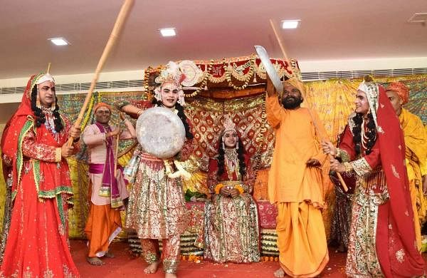 Patna: Artistes perform during 'Lathmar Holi' celebrations in Patna, on March 20, 20129. (Photo: IANS)