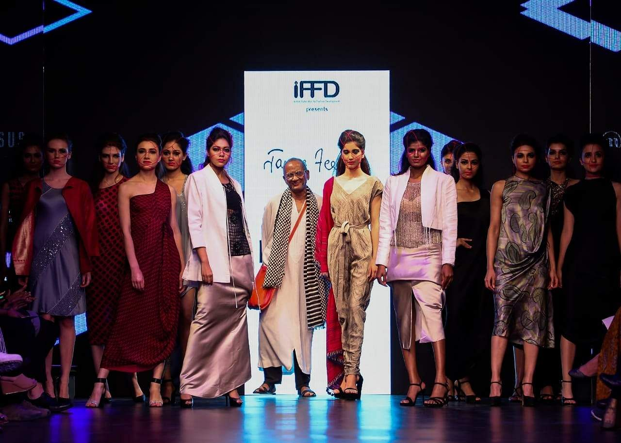 New Delhi: Fashion designer James Ferreira with models showcasing his creations during IFFD'S India Runway Week in New Delhi on March 29, 2019. (Photo: IANS)