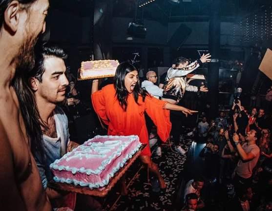 Watch: Priyanka Chopra, Nick Jonasthrow cakes at concert crowd in Miami, video goes viral
