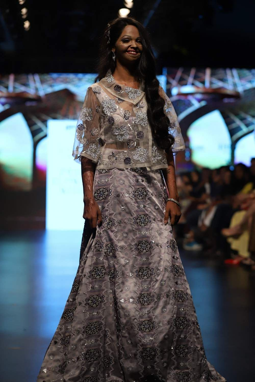 New Delhi: Acid attack survivor Laxmi Agarwal walks the ramp for designer Laxmi Shriali Sood, at IFFD'S India Runway Week in New Delhi on March 29, 2019. (Photo: IANS)