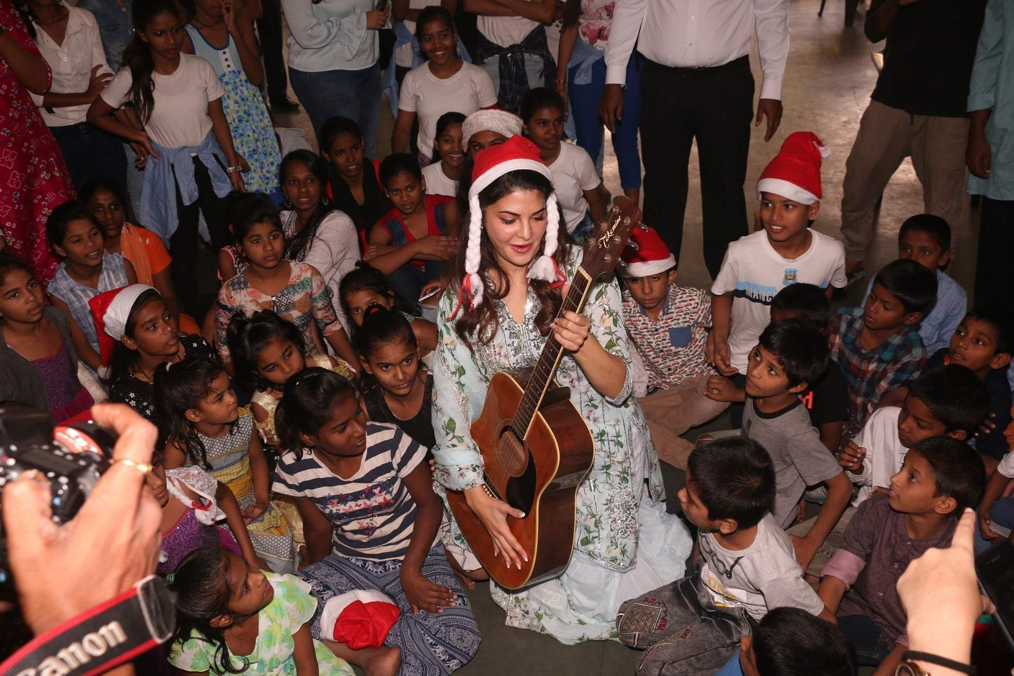 Mumbai: Actress Jacqueline Fernandez celebrates Christmas with underprivileged children in Mumbai's Bandra, on Dec 24, 2018. (Photo: IANS)